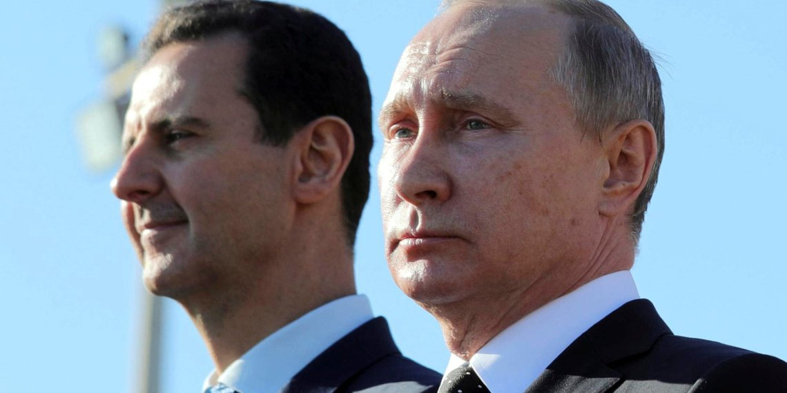 Russian President Vladimir Putin (R) and Syrian President Bashar al-Assad visit the Hmeymim air base in Latakia Province, Syria December 11, 2017. Picture taken December 11, 2017. Sputnik/Mikhail Klimentyev/ via REUTERS/File Photo