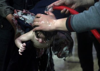 A child is treated in a hospital in Douma, eastern Ghouta in Syria, after what a Syria medical relief group claims was a suspected chemical attack April, 7, 2018. Pcture taken April 7, 2018. White Helmets/Handout via REUTERS
