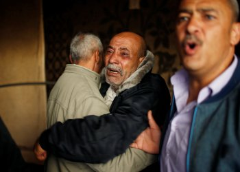 Palestinian relatives of Hamas gunman Mohammed Hejelah, who was killed in an Israeli air strike, mourn during his funeral in Gaza city April 12, 2018. REUTERS/Mohammed Salem
