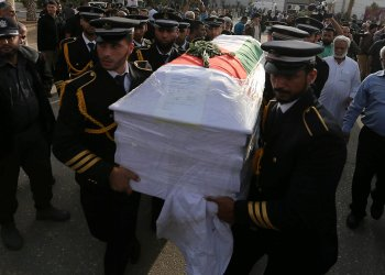 Members of Palestinian Hamas security forces carry a coffin containing the body of Palestinian engineering lecturer Fadi al-Batsh, who was shot dead in Malaysia, in the southern Gaza Strip April 26, 2018. REUTERS/Ibraheem Abu Mustafa