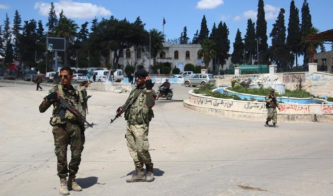 Turkish-backed policemen man a checkpoint in the northwestren Syrian city of Afrin on March 31, 2018 AFP