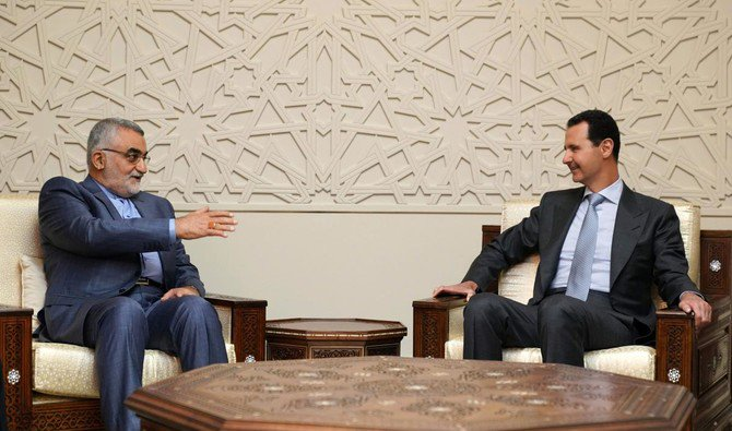 Photo showing Syrian President Bashar al-Assad receiving the chairman of the Iranian parliament's national security committee Alaeddin Boroujerdi in Damascus (AFP)