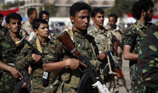 Houthi militants, dressed in army fatigues, march in a parade during a gathering in the capital Sanaa. (AFP)