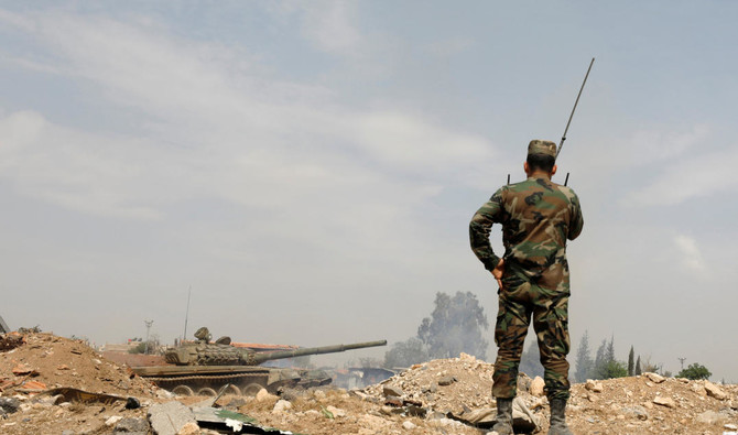 Soldiers loyal to Syria's President Bashar Assad forces are deployed at Al-Qadam area near Yarmouk Palestinian camp in Damascus. Assad has focused on dislodging rebels from their remaining besieged pockets since driving them from eastern Ghouta last month after a fierce offensive. (Reuters)