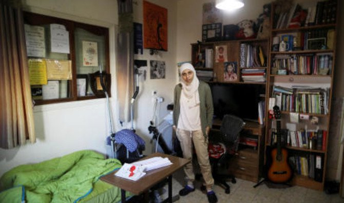 File photo showing Palestinian-Israeli poet Dareen Tatour poses for a picture at her house in Reineh, northern Israel, September 26, 2017. (Reuters)