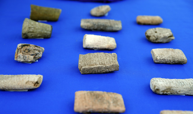 Ancient cuneiform tablets from Iraq that are being returned by Immigration and Customs Enforcement (ICE) are seen during a ceremony at the residence of the Iraqi Ambassador in Washington, US, on May 2, 2018. (AP Photo/Jacquelyn Martin)