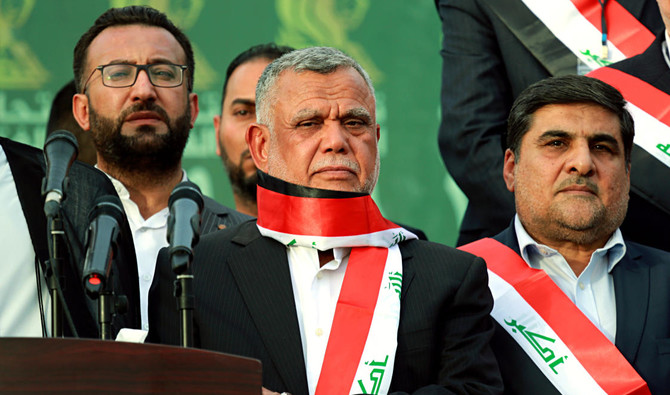Hadi al-Amiri, centre, commander of the Popular Mobilization Forces, attends campaign rally in Baghdad, Iraq, Monday, May 7, 2018. (AP)