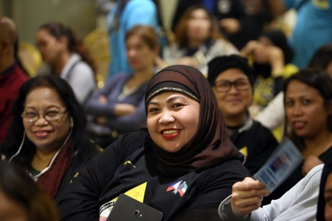 Members of the Filipino community working and residing in Kuwait attend a meeting with senior government officials in Kuwait City on February this year. (AFP)