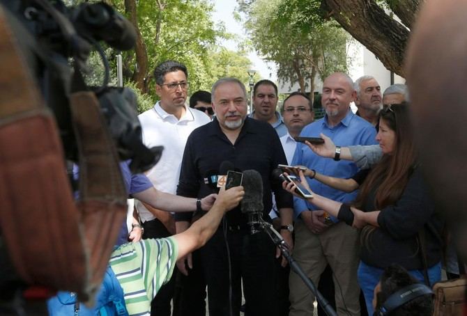 Israeli Defense Minister Avigdor Lieberman (C) talks to reporters during a visit to the Israeli settlement of Katzrin in the Golan Heights. Lieberman urged Syrian President Bashar Assad to expel Iranian forces from his country, after Israeli air strikes hit alleged Iranian targets in Syria. (AFP)