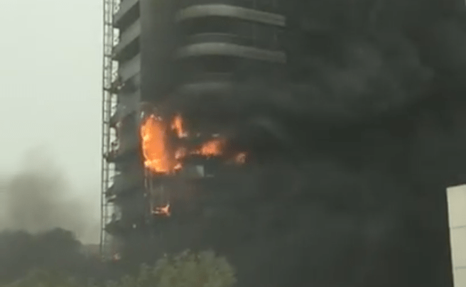 The screengrab from a video shows heavy smoke and flames pouring out of the Zen Tower in Dubai, on May. 12, 2018. (Photo courtesy: YouTube screen grab)