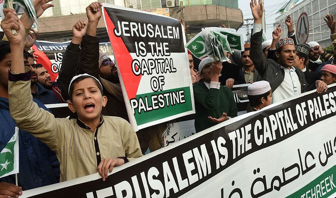 In this file photo, Pakistani demonstrators shout anti-US and Israel slogans in a rally in Lahore on December 14, 2017, following US President Donald Trump's decision to officially recognize Jerusalem as the Israeli capital. (AFP)