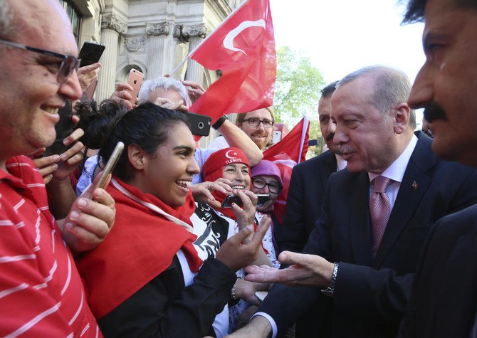 Recep Tayyip Erdogan speaks with supporters, outside a hotel, in London on Tuesday. The Turkish president has lashed out at the international 'silence' surrounding the killing by Israeli security forces of 60 Palestinians on the Gaza border. (AP Photo)