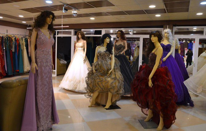 Evening wear and wedding dresses are displayed in a showroom in Mosul. Iraq's second city is a bastion of traditionalism and conservatism, but suitors are finding it increasingly hard to save enough cash to fund a dowry and a wedding. (AFP)