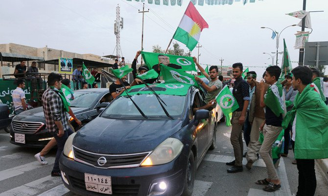 Kurdish supporters of the Patriotic Union of Kurdistan (PUK) celebrate after the closing of ballot boxes during the parliamentary election in Kirkuk, Iraq, on May 12, 2018. (REUTERS/Ako Rasheed)