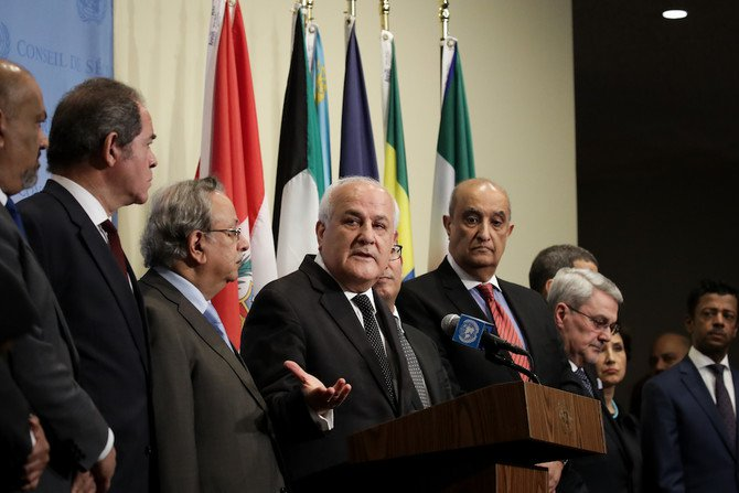 Surrounded by fellow Arab ambassadors to the United Nations, Permanent Observer of Palestine to the UN Riyad Mansour (C) speaks during a press briefing following a UN Security Council meeting concerning the violence at the border of Israel and the Gaza Strip, at United Nations headquarters, May 15, 2018 in New York City. (AFP)