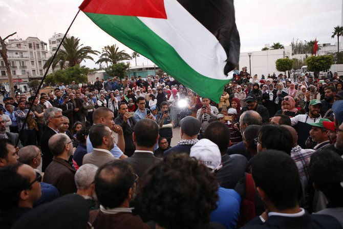 Demonstrators wave flags as they stage a protest to condemn the Israeli fire along the Gaza Strip at United Nation plaza in Casablanca, Morocco, Wednesday, May 16, 2018. (AP)