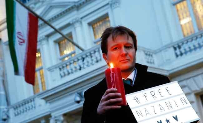 In this file photo dated on Jan. 16, 2017, Richard Ratcliffe husband of imprisoned charity worker Nazanin Zaghari-Ratcliffe, poses for the media during an Amnesty International led vigil outside the Iranian Embassy in London. (AP)