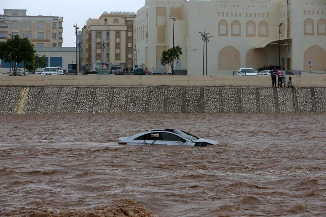 A picture taken on May 26, 2018, shows a car stuck in a flooded street in the southern city of Salalah as the country prepared for landfall of Cyclone Mekunu. (AFP/Mohammed Mahjoub)