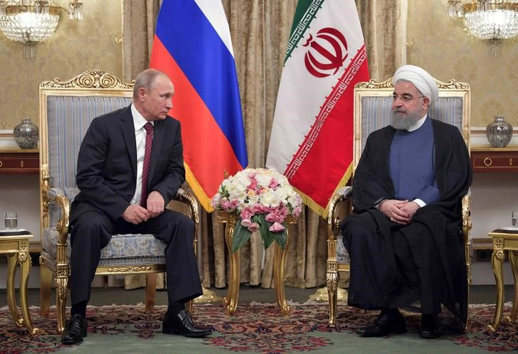 FILE PHOTO - Russian President Vladimir Putin (L) meets with his Iranian counterpart Hassan Rouhani in Tehran, Iran Nov. 1, 2017. Sputnik/Alexei Druzhinin/Kremlin via REUTERS