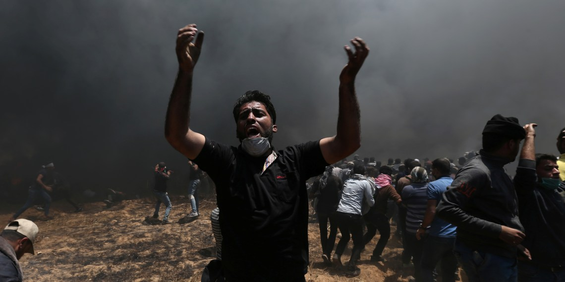 A Palestinian demonstrator shouts during a protest against U.S. embassy move to Jerusalem and ahead of the 70th anniversary of Nakba, at the Israel-Gaza border in the southern Gaza Strip. REUTERS/Ibraheem Abu Mustafa