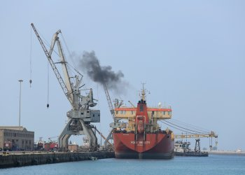 FILE PHOTO: A ship unloads a cargo of fuel at the Red Sea port of Hodeida, Yemen April 1, 2018. REUTERS/Abduljabbar Zeyad/File Photo