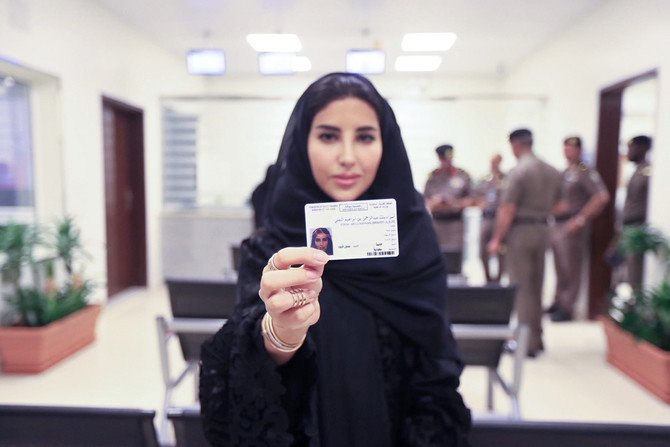 Esraa Albuti, an executive director at Ernst & Young, shows her driving license issued by the General Department of Traffic in Riyadh on Monday. (Saudi Information Ministry photo via AP)