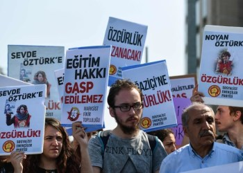 Supporters demonstrate outside the Caglayan courthouse where 21 students from Bogazici University earlier arrested by police are on trial on charges of spreading 'terror propaganda.' (AFP)