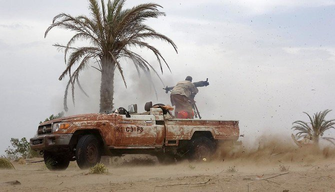 A Pro-government Yemeni soldier fires a B-10 recoil-less rifle on June 7, 2018, near the city of Al Jah in the Hodeidah province, 50 kilometers from the port city. (AFP)