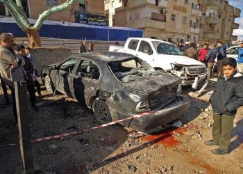 Libyans check the aftermath of an explosion in the eastern city of Benghazi. (File Photo: Abdullah Doma/AFP)