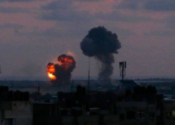 An explosion is seen at Rafah town in the southern Gaza Strip after an air strike by Israeli forces on Wednesday, June 20, in response to rocket fire from the Palestinian territory./ (AFP)