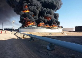 File photo showing smoke and flame rise from an oil storage tank that was set on fire during clashes at Ras Lanuf terminal, the oil crescent, Libya, June 18, 2018. (Reuters)