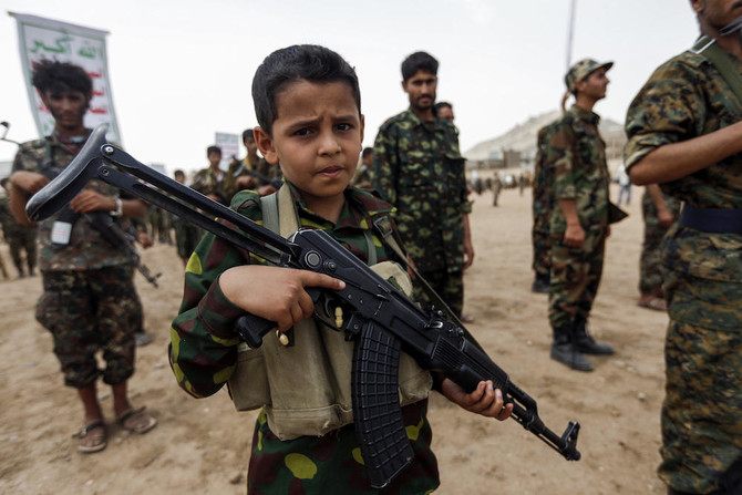 A Yemeni boy poses with a Kalashnikov assault rifle during a gathering of newly-recruited Houthi fighters in the capital Sanaa, to mobilize more fighters to battlefronts in the war against pro-government forces in several Yemeni cities. (File photo: AFP)