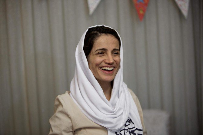 In this file photo taken on September 18, 2013 Iranian lawyer Nasrin Sotoudeh smiles at her home in Tehran after being freed following three years in prison. Iran's award-winning human rights lawyer Nasrin Sotoudeh was arrested on June 13, 2018 (AFP/Behrouz Mehri)