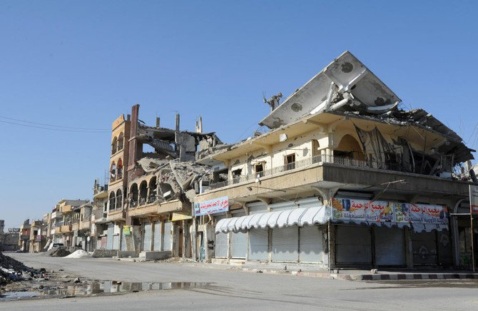 Closed shops are pictured along an empty street in Raqqa, Syria June 24, 2018. (Reuters)