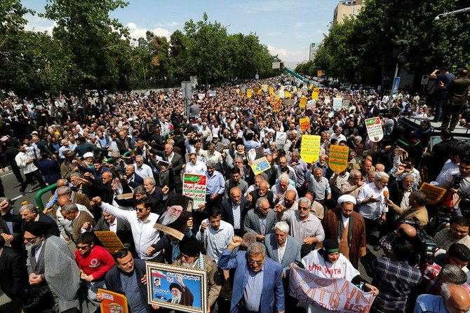 Iranians hold anti-US placards and shout slogans during a demonstration in the capital Tehran on May 11, 2018. (File Photo: AFP)