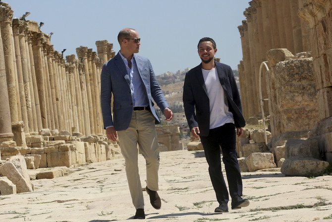 Britain's Prince William and Jordan's Crown Prince Hussein tour the archaeological site in Jerash, northern Jordan, on Monday./ (AP)