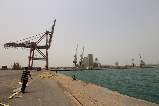A man walks at the ship docking area at the Red Sea port of Hodeidah, Yemen June 24, 2018. /(Reuters)