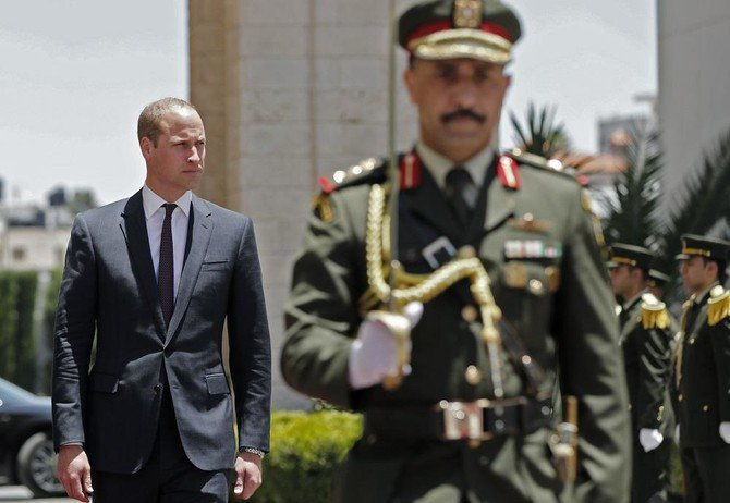 Britain's Prince William walks to meet the Palestinian President Mahmud Abbas in the West Bank city of Ramallah on June 27, 2018./ (AFP)
