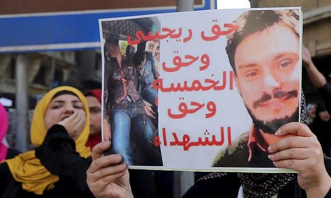 Giulio Regeni – seen here on a posted held by an Egyptian activist – was killed in late January or early February. Italian officials say Egypt is not serious about helping find his murderers. (Reuters)