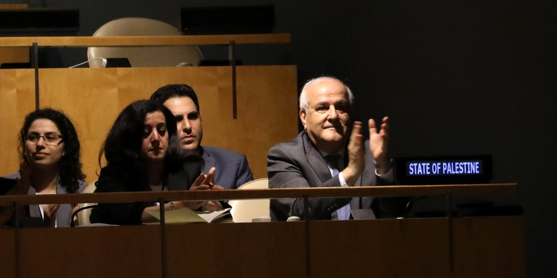 Palestinian Ambassador to the United Nations Riyad Mansour applauds following the adoption of a draft resolution by the United Nations General Assembly to deplore the use of excessive force by Israeli troops against Palestinian civilians at U.N. headquarters in New York, U.S., June 13, 2018. REUTERS/Mike Segar