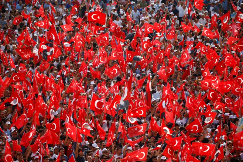 Supporters of Muharrem Ince, presidential candidate of the main opposition Republican People's Party (CHP), wave flags during an election rally in Izmir, Turkey. REUTERS/Osman Orsal