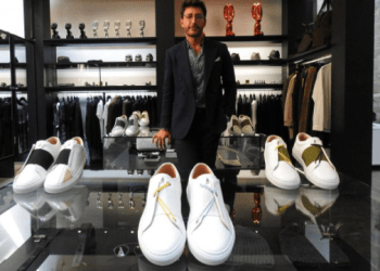 Syrian designer Daniel Essa poses with his prototype luxury sneakers displayed to be seen for online sale at a concept store in Lille, France, June 6, 2018. Picture taken June 6, 2018. REUTERS/Noemie Olive