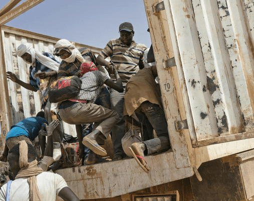 Migrants climb into a truck to head north into Algeria at the Assamaka border post in northern Niger on Sunday, June 3, 2018. (Jerome Delay/AP)