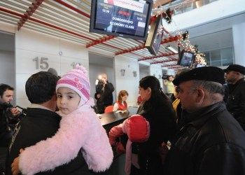 Passengers check in at Tbilisi airport for the flight to Moscow on January 8, 2010. (File photo: AFP)