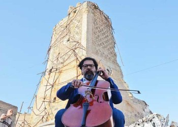 Famed Iraqi maestro and cello player Karim Wasfi performs in front of the Great Mosque of Al-Nuri. (File/AFP)