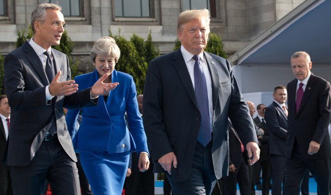 NATO Secretary-General Jens Stoltenberg, Prime Minister of the United Kingdom Theresa May, US President Donald Trump and President of Turkey Recep Tayyip Erdogan arrive for a working dinner at The Parc du Cinquantenaire — Jubelpark Park in Brussels on July 11, 2018, during the North Atlantic Treaty Organization (NATO) summit. (AFP / POOL / BENOIT DOPPAGNE)