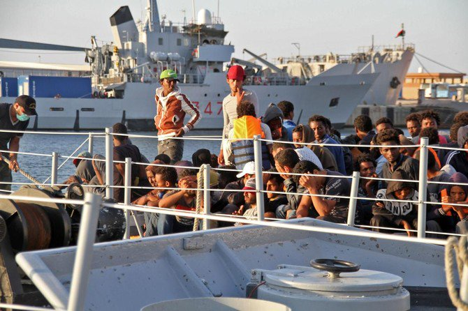African migrants, who according to the Libyan navy were rescued by the country's coast guard, arrive at the naval base of the capital Tripoli on July 12. (AFP)