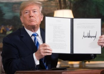 US President Donald Trump, pictured here after signing the document reinstating sanctions against Iran, had said the Iranians would 'would come back to the table,' the Iranians say that won't happen. (Saul Loeb/AFP)