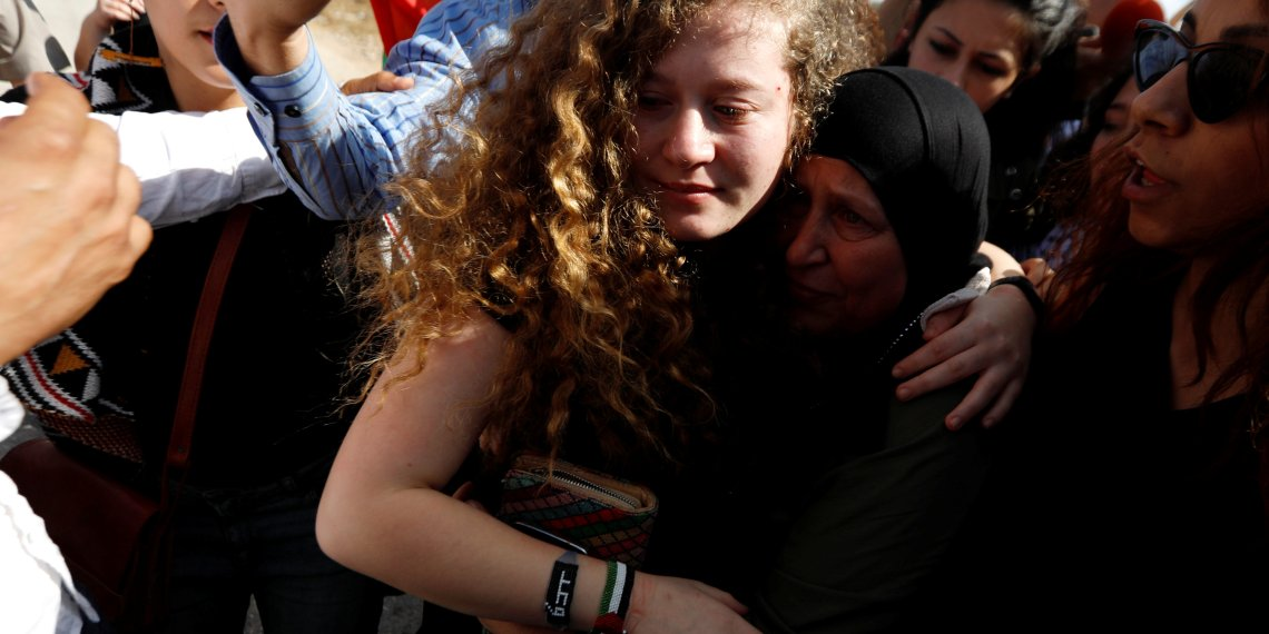Palestinian teenager Ahed Tamimi is welcomed by relatives and supporters after she was released from an Israeli prison, at Nabi Saleh village in the occupied West Bank July 29, 2018. REUTERS/Mohamad Torokman