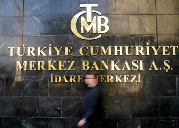FILE PHOTO: A man leaves Turkey's Central Bank headquarters in Ankara, Turkey, April 19, 2015. REUTERS/Umit Bektas